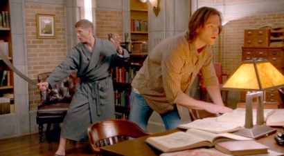 Dean mucking about whilst Sam is immersed in books ........